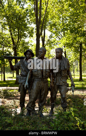 A bronze statue,The Three Soldiers (sometimes called The Three Servicemen) a memorial to soldiers who fought in - Stock Photo