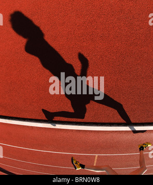 shadows of runners during 800m race during outdoor track and field competition - Stock Photo
