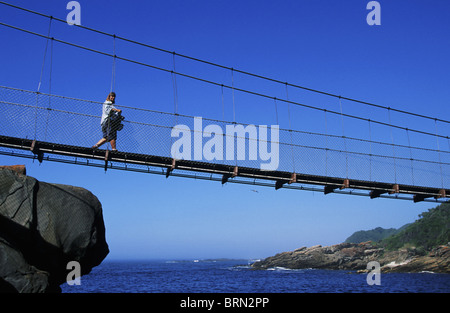 The swing bridge over the Storm River Mouth on the Tsitsikama coast located on the Garden route - Stock Photo
