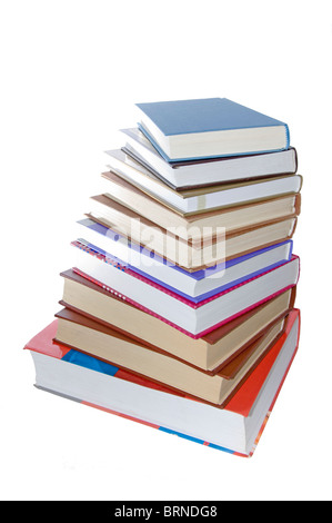 A lot of books, tower made of books against a white background - Stock Photo