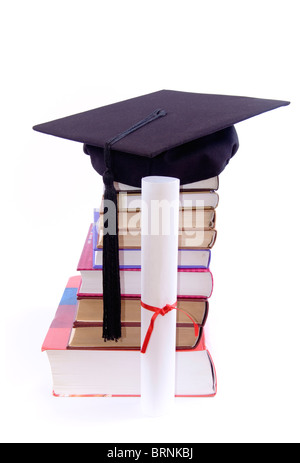 A lot of books, tower made of books with student hat on it, and diploma, against a white background - Stock Photo