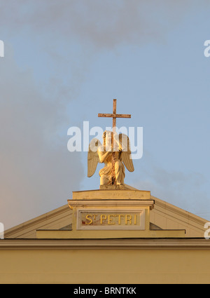 Angel and cross above the entrance to the German Lutheran St. Petri Church, Peterkirche, Nevsky Prospect, St Petersburg, - Stock Photo