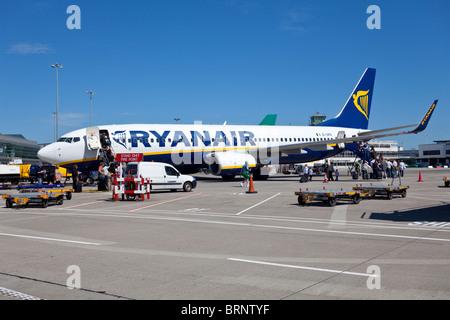 passengers boarding RyanAir flight, Dublin airport, Ireland - Stock Photo