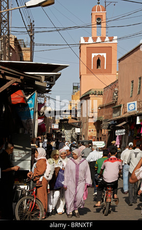 MARRAKESH: MUSLIM WOMEN ON BUSY SHOPPING STREET - Stock Photo