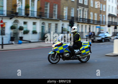 Police officer on motorcycle in London - Stock Photo
