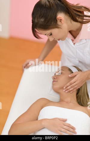 Body care - Woman receive luxury facial massage at day spa - Stock Photo