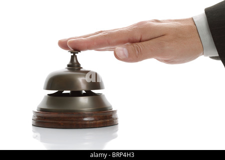 Ringing hotel reception bell - Stock Photo
