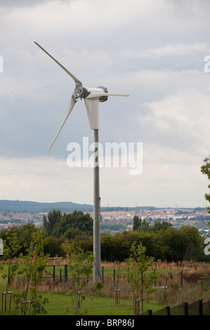 Small wind turbine in the ground of a school in England. - Stock Photo