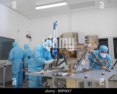 Workers building satellite dish - Stock Photo