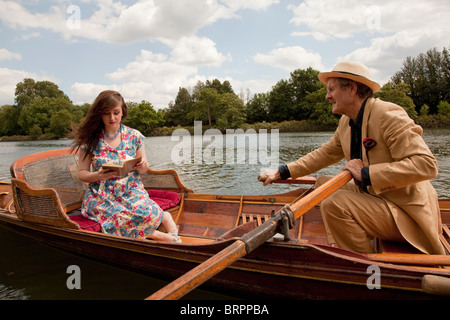 Father and daughter on a vintage boat - Stock Photo