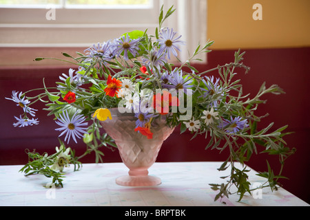Flowers in vases and an English Garden - Stock Photo