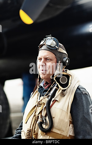 Pilot in command of Lancaster bomber, dressed in world war two flight suit, Winnipeg, Manitoba, Canada - Stock Photo