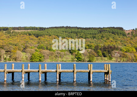 Wooden jetty on a lake England UK - Stock Photo
