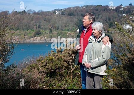 England Devon East Portlemouth Couple walking coast path near Biddlehead Point - Stock Photo