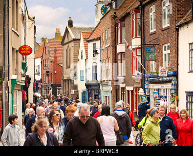 Crowded busy shopping street Whitby, North Yorkshire, England, UK - Stock Photo