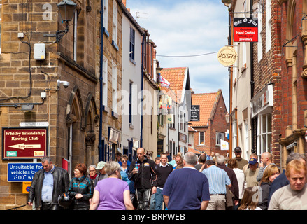 Crowded busy shopping street Whitby North Yorkshire England UK - Stock Photo