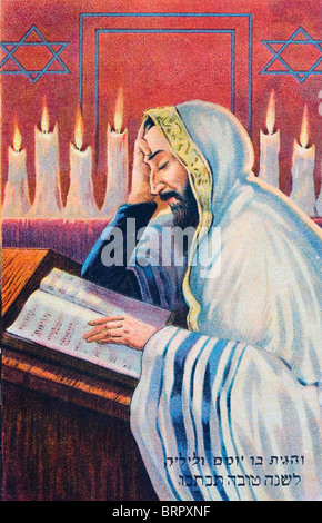 Early 20th century postcard depicting Jewish religious practice. Studying sacred text. - Stock Photo