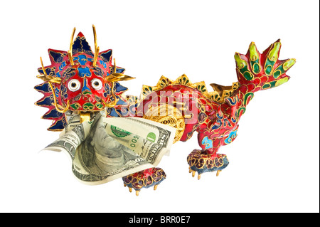 Chinese dragon with American dollar in mouth. Dragon devours dollar. Close-up. - Stock Photo