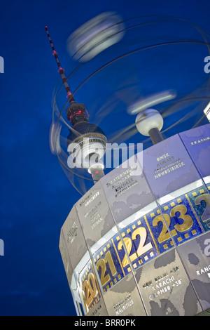 Alexanderplatz world clock and television tower at night, berlin, germany - Stock Photo