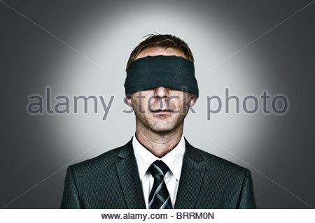 Man blindfolded - Stock Photo