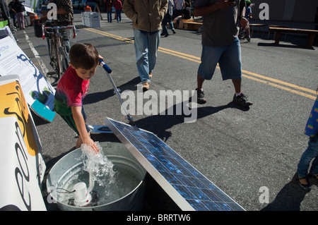 A solar panel is demonstrated running a pump at a green street fair in Brooklyn in New York - Stock Photo