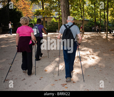 Paris, France,  Group Senior People Couple, Exercising, Nordic Walking  in Luxembourg Park, Jardin du Luxembourg - Stock Photo