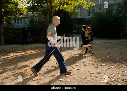 Paris, France, Senior Man Exercising, Nordic Walking in 'Luxembourg Park', 'Jardin du Luxembourg' - Stock Photo