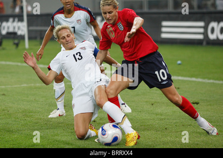 Kristine Lilly of the USA (13) defends against Kelly Smith of England (10) during a 2007 Women's World Cup quarterfinal - Stock Photo