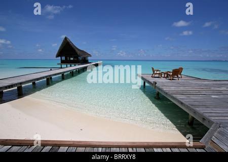 A Beach Bar Scene on Kuramathi, a tropical island resort on the Maldives - Stock Photo