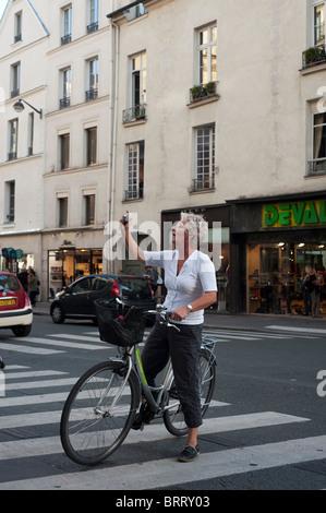 Paris, France, Adult Tourists Visiting Paris by Bicycle Tour, Saint Germain des Pres District, Woman Taking Photos - Stock Photo