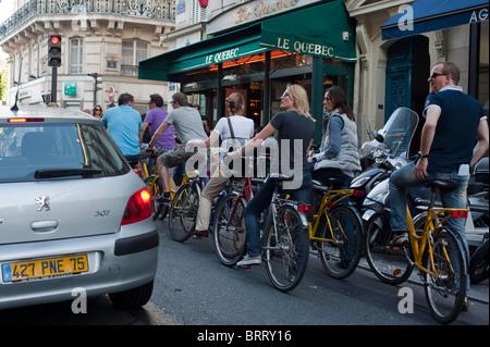 Paris, France, Adult Tourists Visiting Paris by Bicycle Tour, Saint Germain des Pres District - Stock Photo
