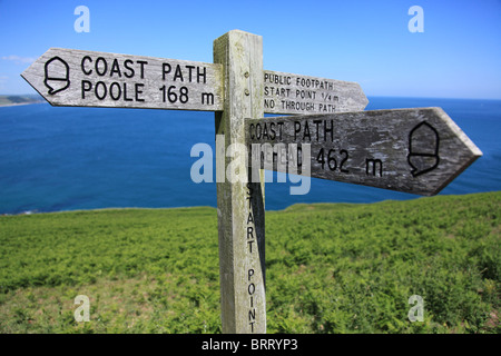 Signpost on South West coast path at Start Point, Devon - Stock Photo