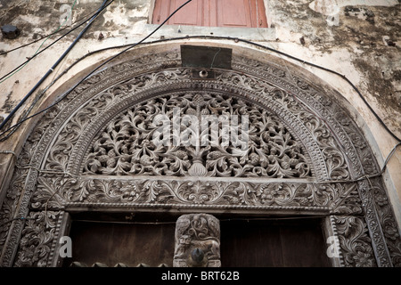 Zanzibar, Tanzania. Carved Wooden Door, Indian Style (Rounded Top), Stone Town. - Stock Photo