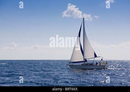 Yacht sailing on port tack, off Paxos, Greece - Stock Photo