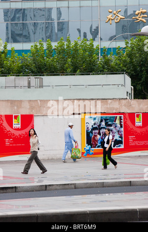 People walking on the street in Shanghai China - Stock Photo