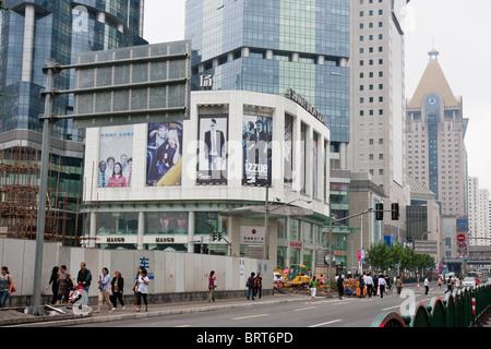 Pudong street scene in Shanghai China - Stock Photo