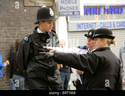 A Police Man and Two Police Women at the Notting Hill Carnival 2010 - Stock Photo
