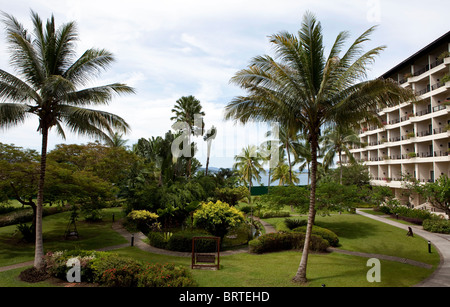 A view of a garden at the Tanjung Ari Resort & Spa in Kota Kinabalu in Sabah, Malaysian Borneo - Stock Photo