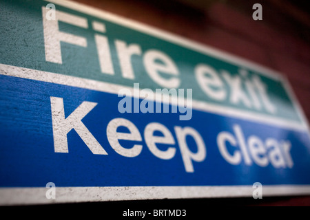 Fire Exit Keep Clear Sign - Stock Photo