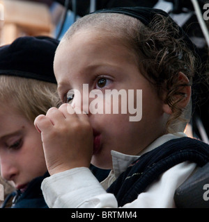 portrait of a young orthodox jewish boy sucking his thumb Stock Photo