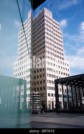 Part of the Beisheim Center reflecting in the facade of the Bahn Tower at Potsdamer Platz in the German capital - Stock Photo