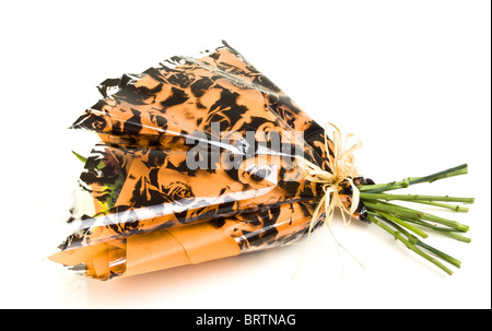 Beautiful Flower Bouquet wrapped in cellophane and tied with a bow isolated on white. - Stock Photo