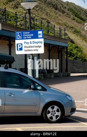 Car parked in a disabled badge holders bay at a pay and display car park at Cromer, Norfolk, England - Stock Photo