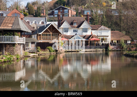 Guildford Surrey England UK The Weyside riverside pub reflected in River Wey on Godalming Navigation - Stock Photo