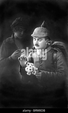 First World War soldier, she loves me, she loves me not, historic photgraph, around 1915 - Stock Photo