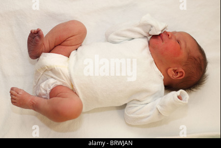Newborn baby girl couple of hours after birth - Stock Photo