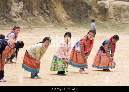 flower h'mong school girls exercising, cao son, Vietnam - Stock Photo