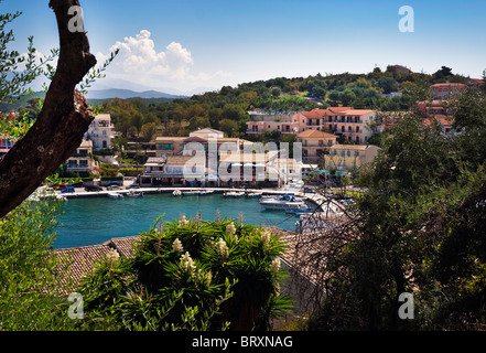 Kassiopi Village Bay Harbour, Corfu, Ionian Islands Greece. - Stock Photo