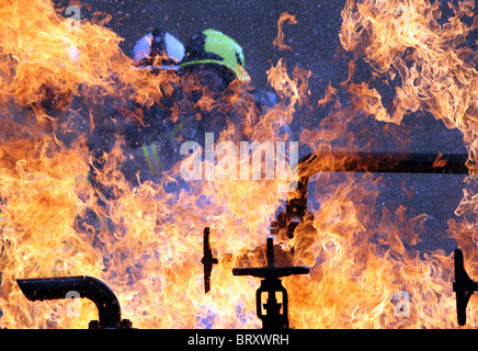 Fire fighters tackle a simulated blaze during training at Cardiff Wales, UK. - Stock Photo