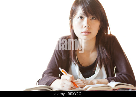 Young woman studying, Japan - Stock Photo